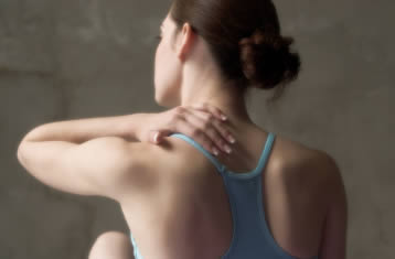 A ballerina with neck pain